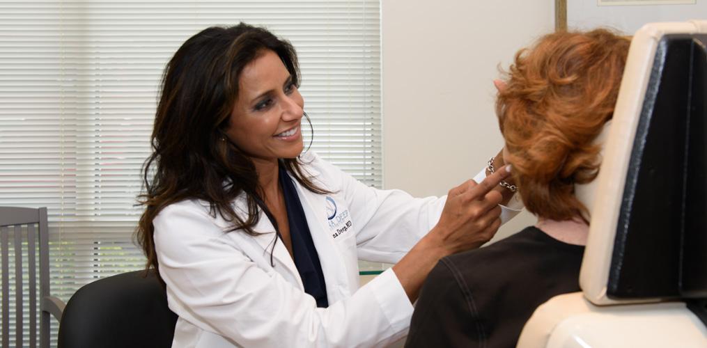 Dr. Nina Deep performing procedure on patient in office